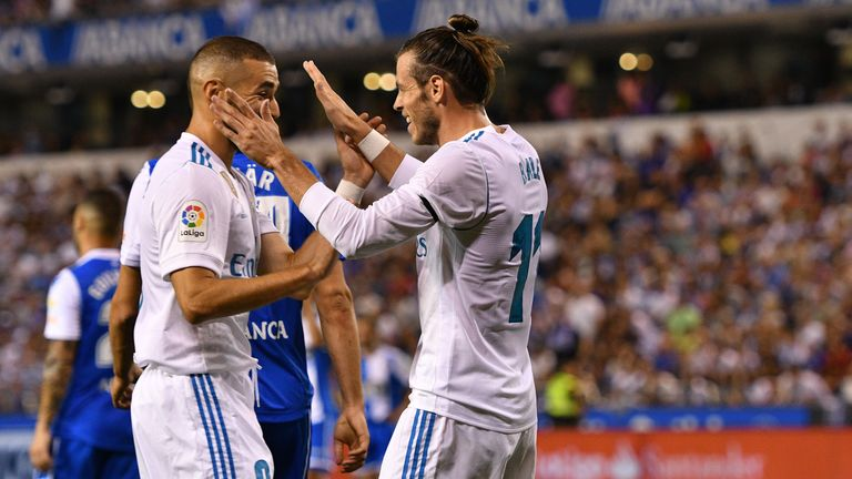LA CORUNA, SPAIN - AUGUST 20: Gareth Bale of Real Madrid scores the first goal and celebrates whit teammates during the La Liga match between Deportivo La
