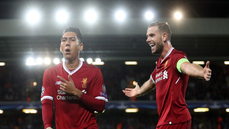 Roberto Firmino of Liverpool celebrates scoring his side's fourth goal with Jordan Henderson of Liverpool during the UEFA Champions League tie v Hoffenheim