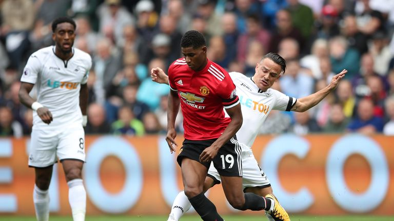 Marcus Rashford and Roque Mesa battle for the ball at the Liberty Stadium