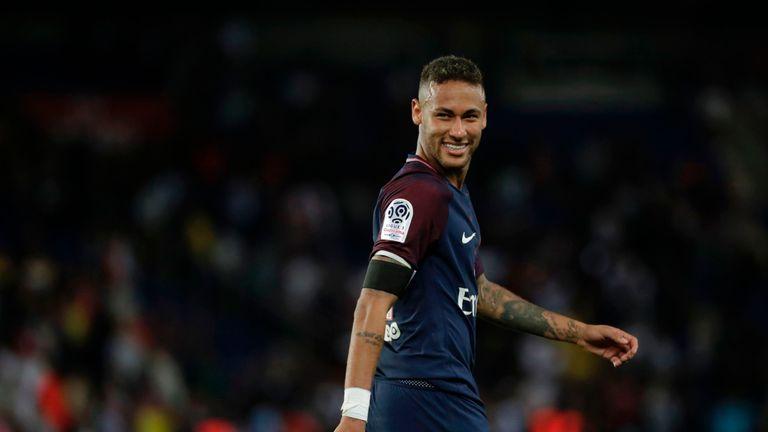 Paris Saint-Germain's Brazilian forward Neymar smiles  during the French L1 football match Paris Saint-Germain (PSG) vs Toulouse FC (TFC)