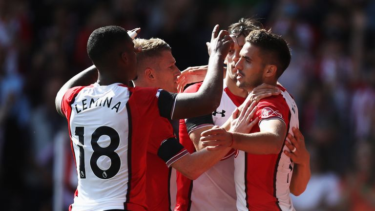 Dusan Tadic is congratualted by his team-mates after converting from the penalty spot