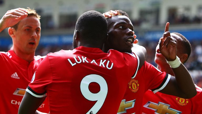 Paul Pogba celebrates with Romelu Lukaku during Manchester United's 4-0 win at Swansea