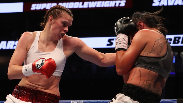 Savannah Marshall throws a punch at Sydney LeBlanc during their super middleweight bout on August 26, 2017 at T-Mobile Arena.