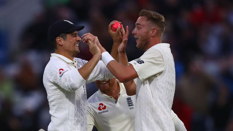 Stuart Broad celebrates with Alastair Cook after overtaking Ian Botham's Test match tally