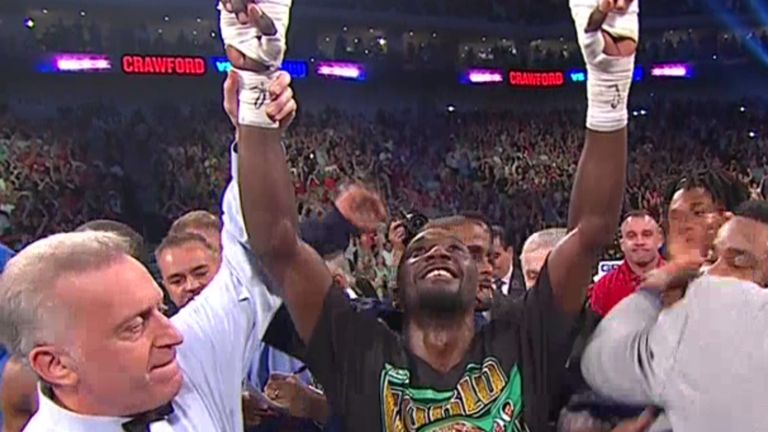 Terence Crawford celebrates after becoming the undisputed champion with victory over Julius Indongo