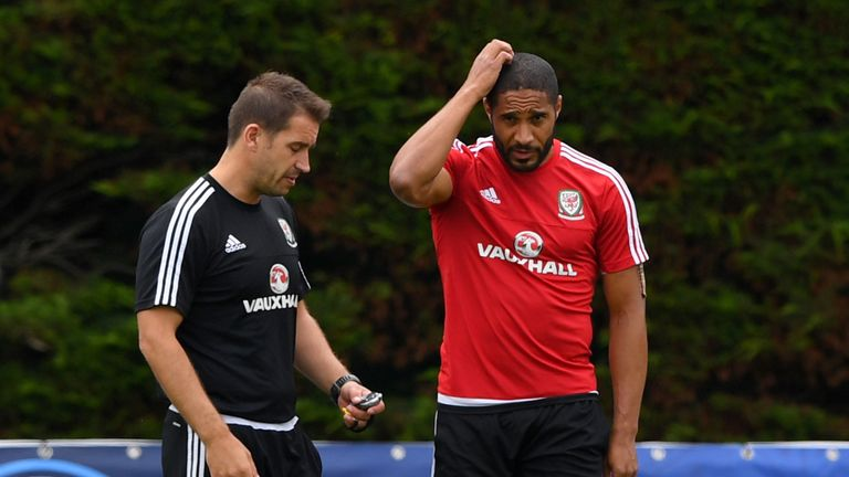 Owen in conversation with Wales captain Ashley Williams in training