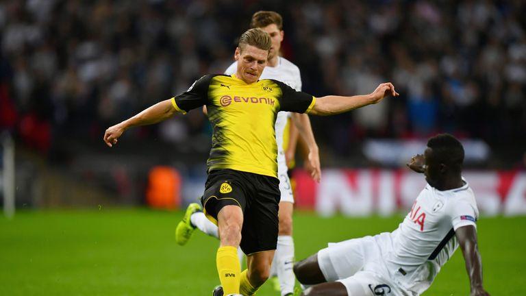 Sanchez with a tackle on Dortmund's Lukasz Piszczek at Wembley