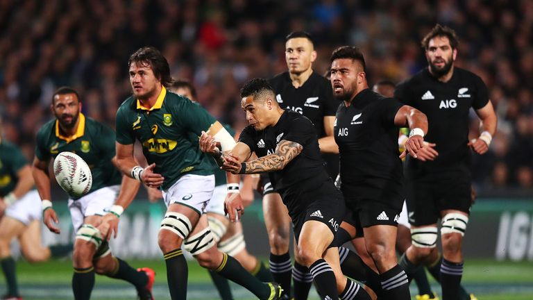 New Zealand's Aaron Smith passes the ball out during the Rugby Championship match against South Africa