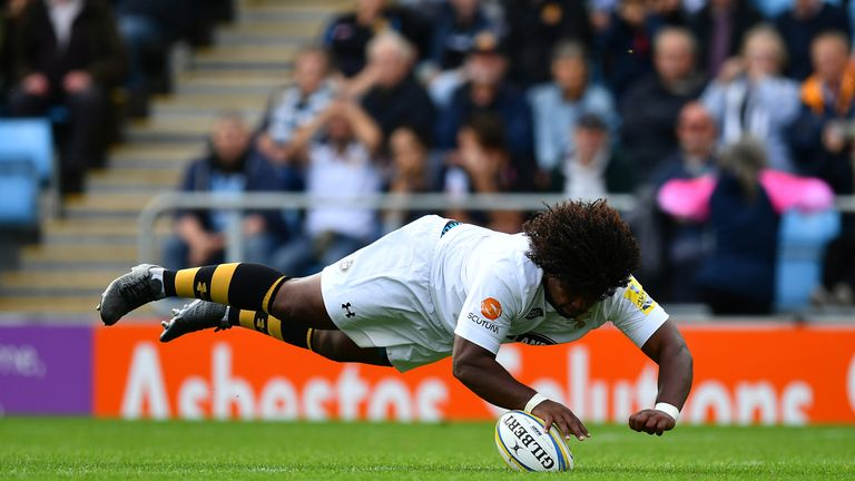 Ashley Johnson of Wasps dives over to score against Exeter Chiefs