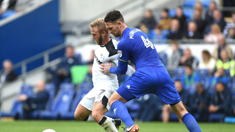 Sean Morrison and Johnny Russell battle for the ball during the Sky Bet Championship match at Cardiff City Stadium