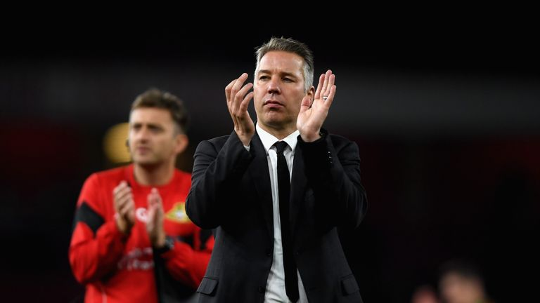 Doncaster manager Darren Ferguson shows his appreciation to the travelling fans