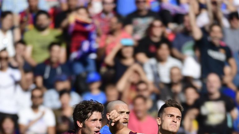 Denis Suarez and Sergi Roberto celebrate during Barcelona's win over Getafe