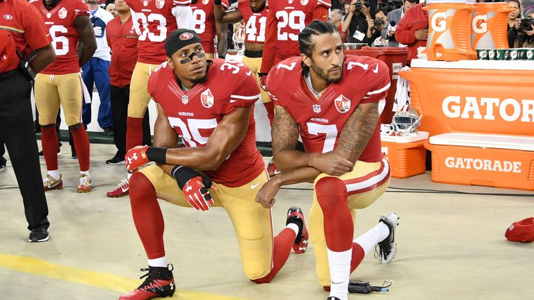 Colin Kaepernick, right, and Eric Reid of the San Francisco 49ers kneel in protest during the national anthem