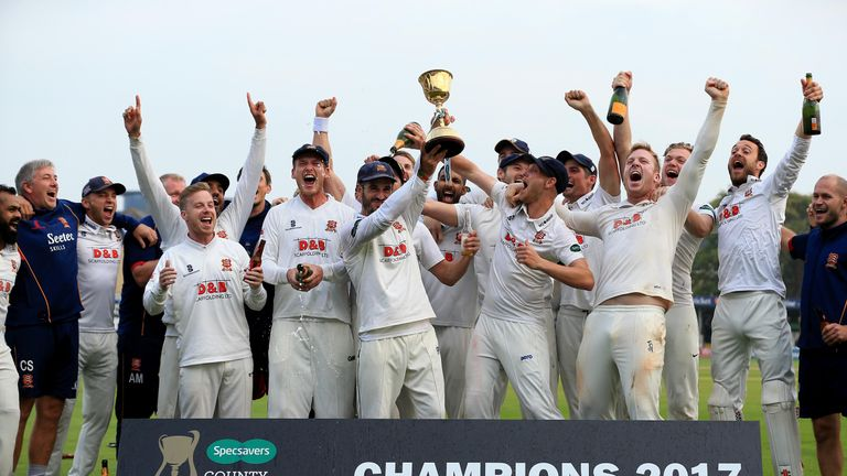 Essex's players lift the 2017 County Championship trophy