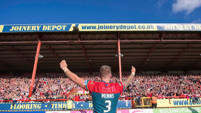 Thomas Minns celebrates to the fans after his side regain their place in Super League.