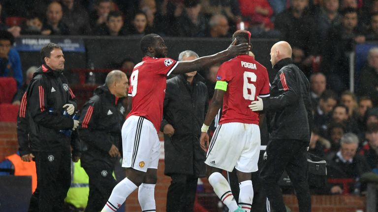 Romelu Lukaku embraces Pogba as he goes off