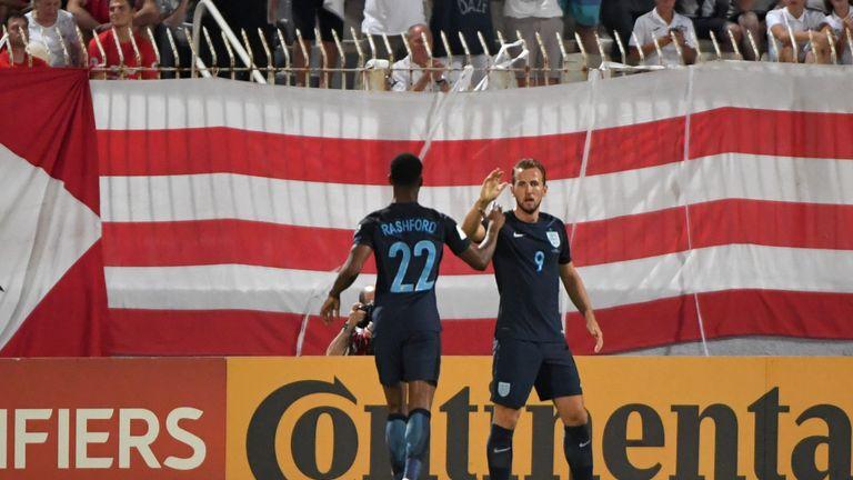Kane celebrates England's opener with Marcus Rashford