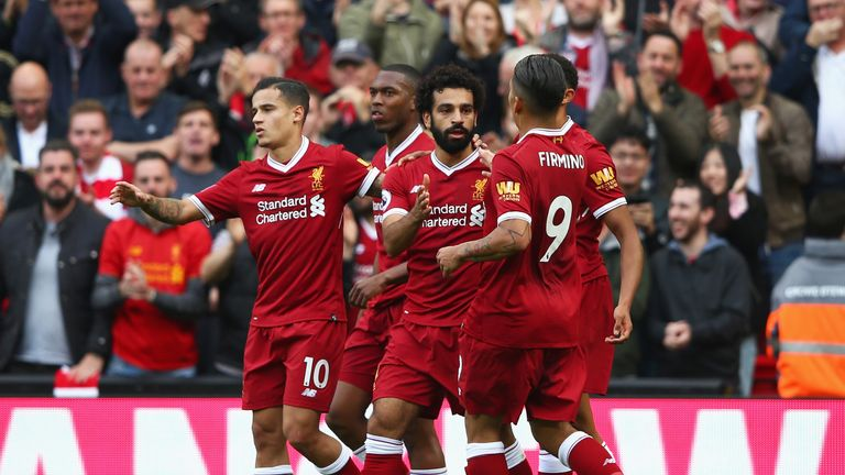 Mohamed Salah celebrates his equaliser in the first half at Anfield