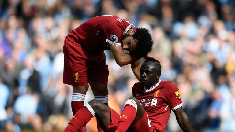 Mohamed Salah comforts Sadio Mane after he was issued with a red card