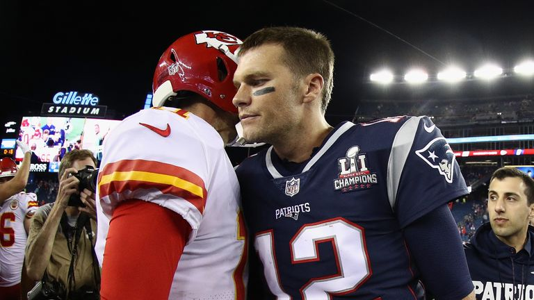 Tom Brady talks with Alex Smith after the 42-27 defeat to the Kansas City Chiefs