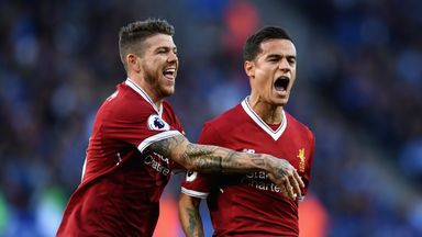 Philippe Coutinho celebrates after putting Liverpool two up at Leicester