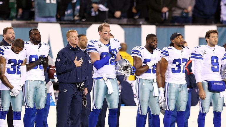 PHILADELPHIA, PA - DECEMBER 14:  Jason Garrett head coach of the Dallas Cowboys lines up with his team during the national anthem prior to the game against