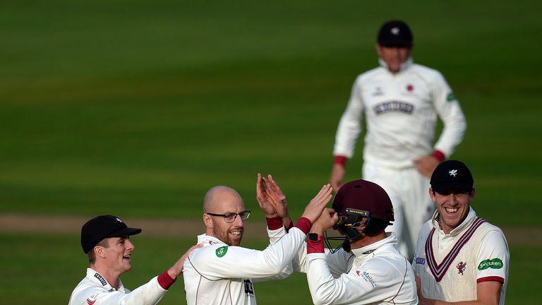 Jack Leach (2L) of Somerset celebrates after dismissing Sam Robson of Middlesex