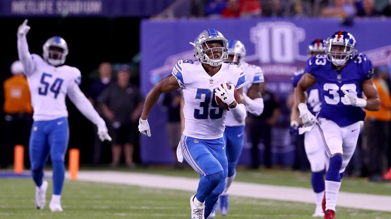 EAST RUTHERFORD, NJ - SEPTEMBER 18:  Jamal Agnew #39 of the Detroit Lions returns an 88 yard punt return for a touchdown in the fourth quarter against the