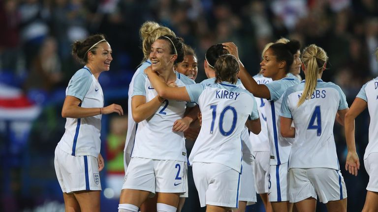 Lucy Bronze is congratulated by team-mates after scoring England's fourth