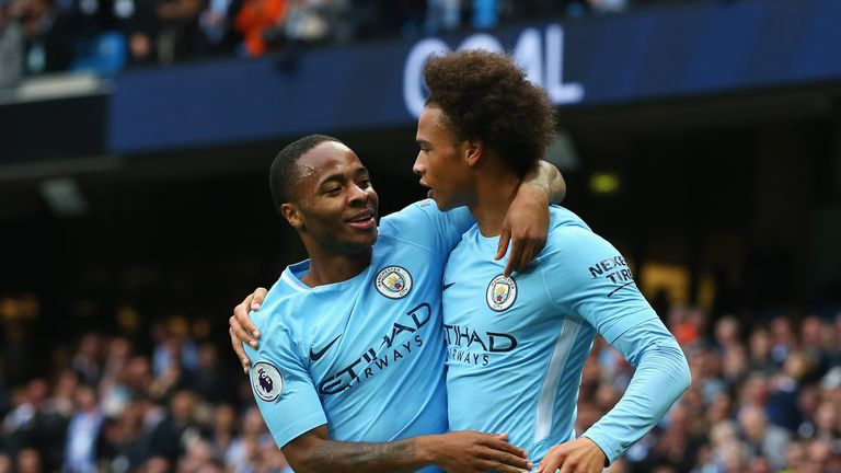 MANCHESTER, ENGLAND - SEPTEMBER 23:  Raheem Sterling (L) of Manchester City celebrates scoring his sides second goal with his team mate Leroy Sane (R) duri