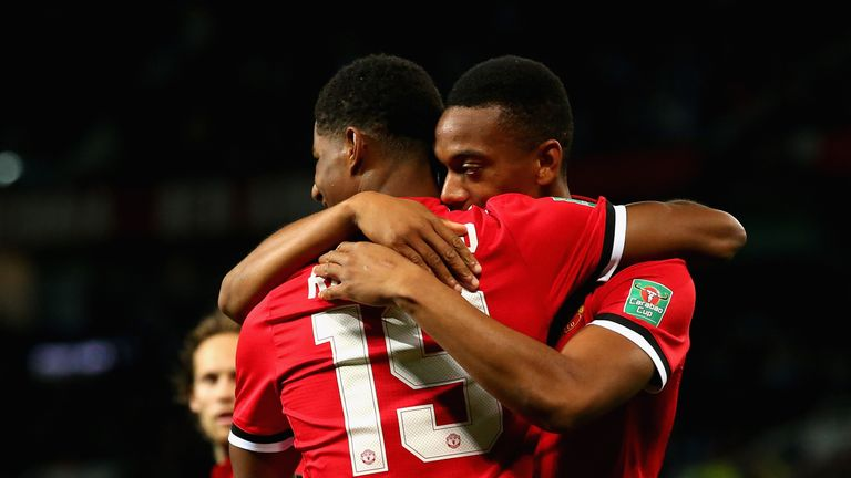 MANCHESTER, ENGLAND - SEPTEMBER 20:  Marcus Rashford of Manchester United celebrates scoring his sides first goal with Henrikh Mkhitaryan of Manchester Uni