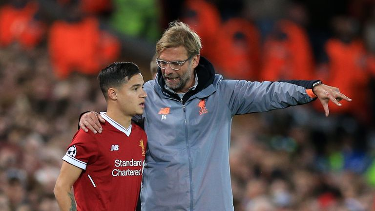 Philippe Coutinho prepares to be subbed on by Liverpool manager Jurgen Klopp during the UEFA Champions League, Group E match v Sevilla at Anfield