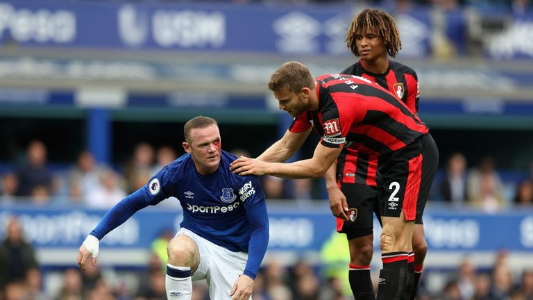 LIVERPOOL, ENGLAND - SEPTEMBER 23: Simon Francis of AFC Bournemouth checks if Wayne Rooney of Everton is okay during the Premier League match between Evert