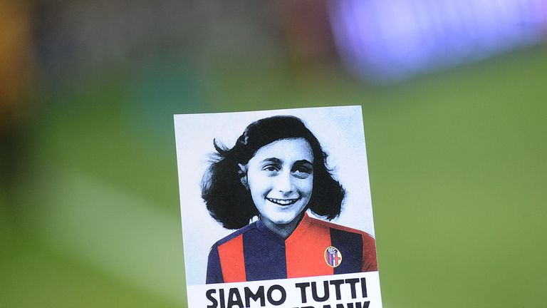 A sticker with the image of Anna Frank wearing the jersey of Bologna FC that says 'we are all Anne Frank'