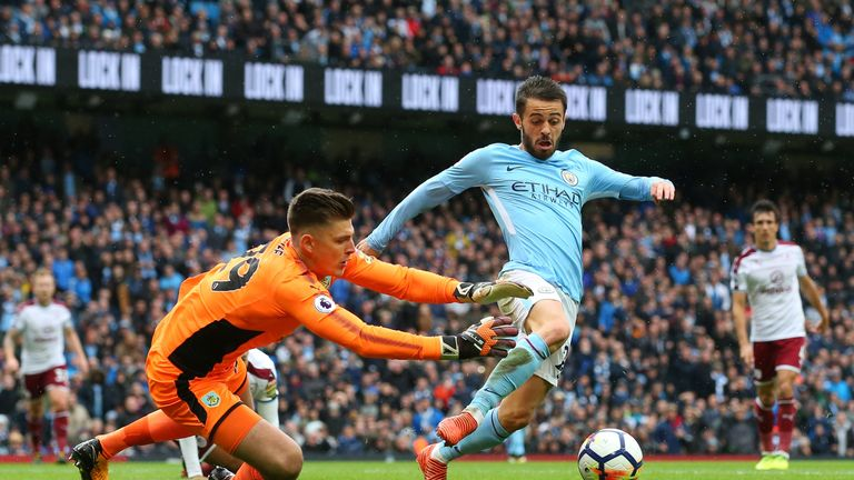 Bernardo Silva went to ground under the challenge of Burnley goalkeeper Nick Pope