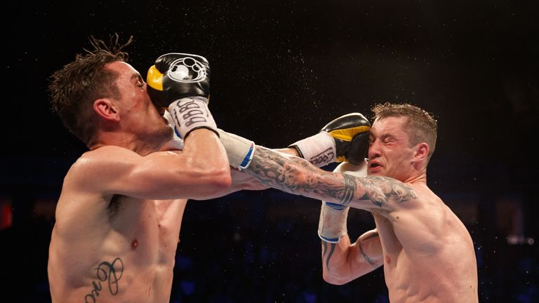 Anthony Crolla and Ricky Burns during a bout in Manchester on Saturday