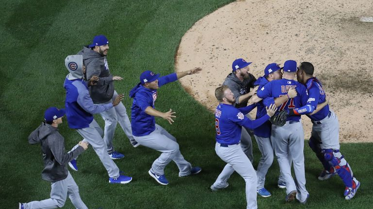 The Chicago Cubs celebrate after a thrilling 9-8 victory