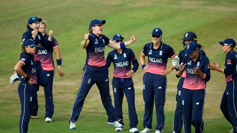 England captain Heather Knight (c) jumps with joy after Australia batsman Alyssa Healy is given out after review
