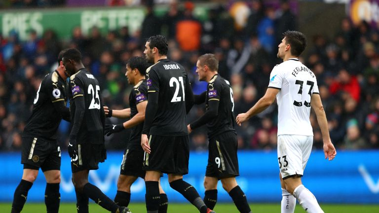 Swansea defender Federico Fernandez (right) shows his dejection after scoring an own goal against Leicester