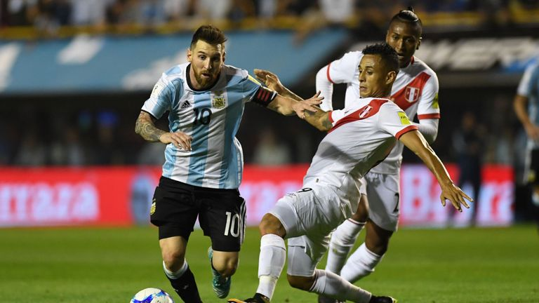 Argentina's Messi (left) is marked by Peru's Victor Yotun