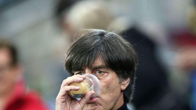 Germany's coach Joachim Low insisted his players would not be celebrating in Belfast after World Cup qualification