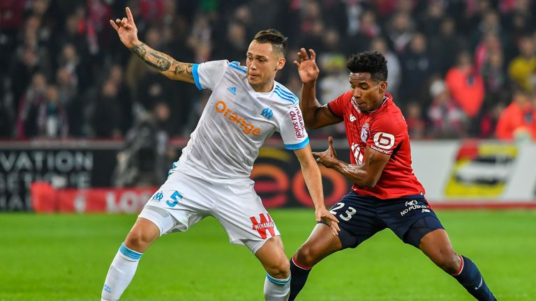 Marseille's Lucas Ocampos (L) vies with Lille forward Thiago Mendes in the Ligue 1 clash