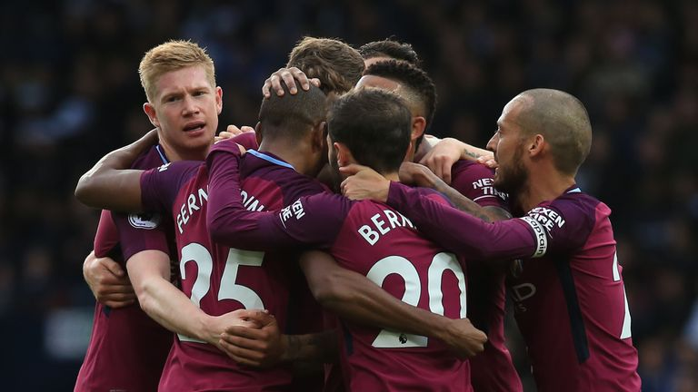 Fernandinho is mobbed by team-mates after scoring Manchester City's second