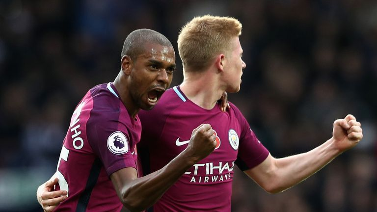 Fernandinho celebrates adding a second for Manchester City with Kevin De Bruyne