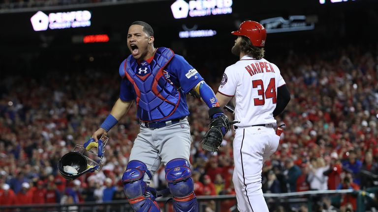 Willson Contreras celebrates after Bryce Harper struck out to end the game