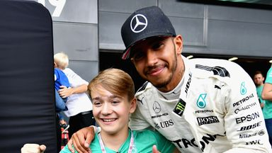 Billy Monger, who lost his legs in a near-fatal crash, has carried out a charity walk at Brands Hatch - raising £850,000