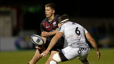 Owen Farrell of Saracens draws Guy Mercer of Ospreys during the sides thrilling European Rugby Champions Cup match