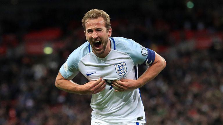 Harry Kane celebrates after scoring England's late winner against Slovenia