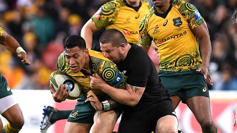 Israel Folau is tackled by Dane Coles