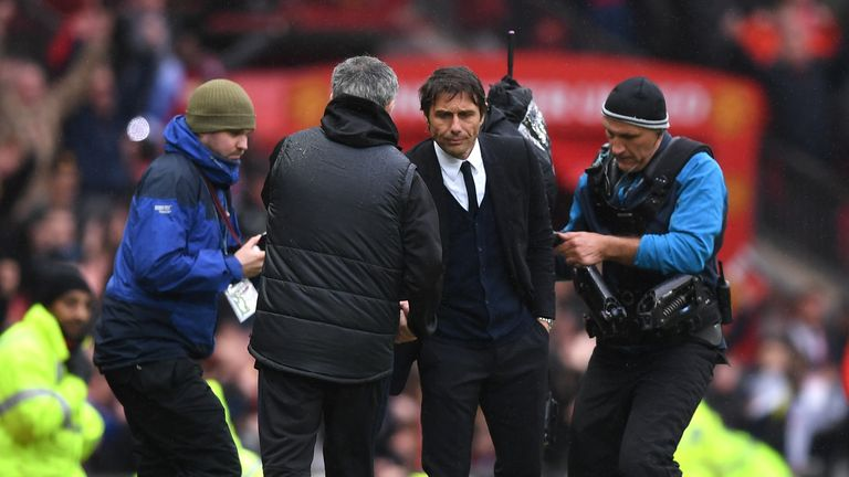 MANCHESTER, ENGLAND - APRIL 16: Jose Mourinho, Manager of Manchester United and Antonio Conte, Manager of Chelsea shake hands after the Premier League matc